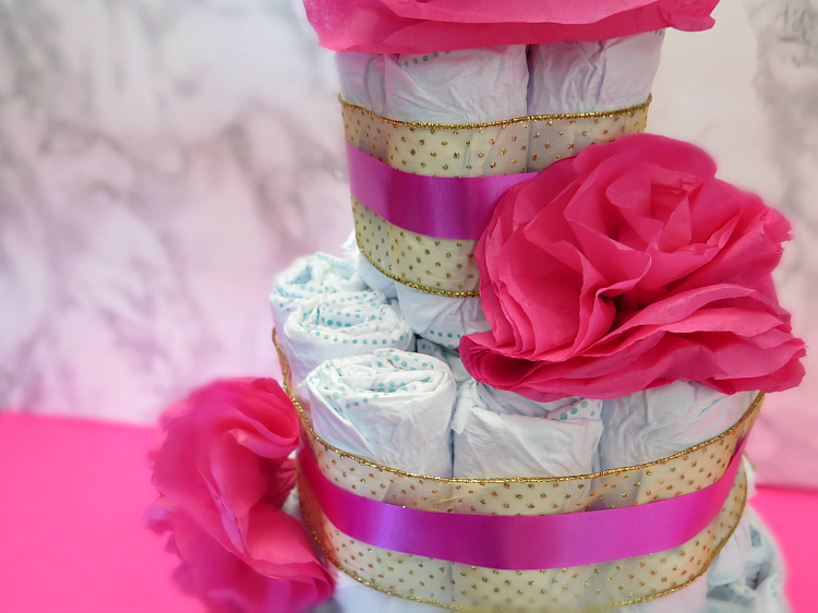 The diaper cake is a classic staple at any baby shower. Step it up a notch with this modern sophisticated twist on the classic for your next shower!