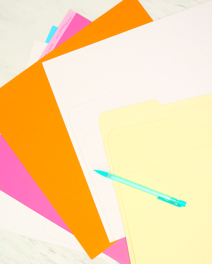 Read this easy tutorial for colorful DIY file folders to keep ALL your paper clutter organized! I keep these in our command center and add a label to each!